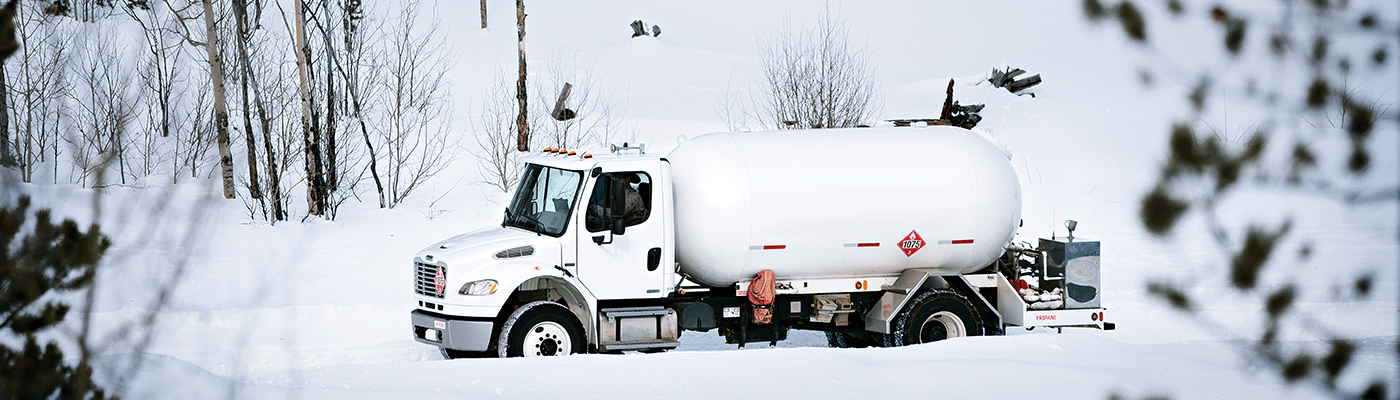 Bobtail Truck Driving On Snow Covered Road